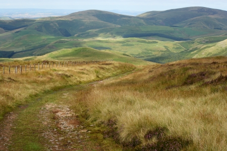 footpath across rolling hills in Northumberland National Park