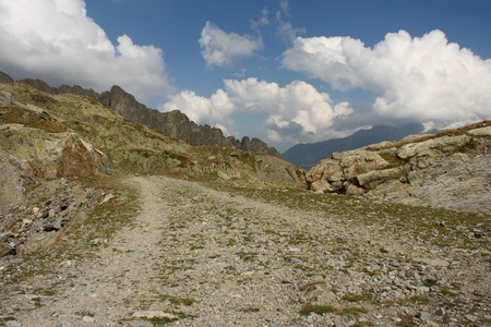 winding footpath in Aiguilles Rouges in French Alps  Stock Photo - 15932352