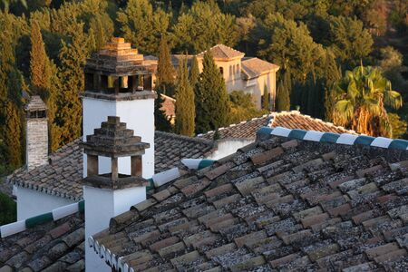 roofs and chimneys of houses in Albayzin, Granada photo