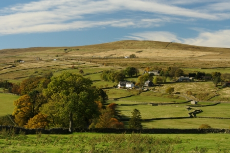 rolling hills in Northumberland in early autumn Stock Photo