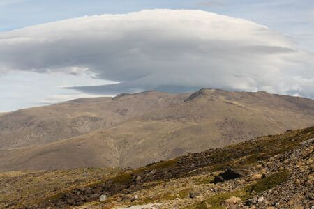 lenticular: lenticular cloud above Sierra Nevada National Park, Spain