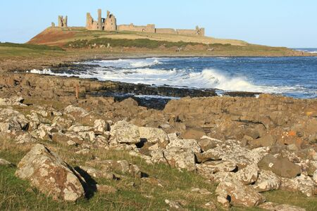Dunstanburgh castle in Northumberland photo