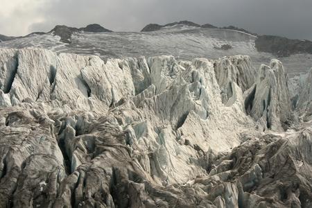 melting glacier with deep crevasses