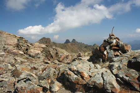 cairn marking way in Aiguilles Rouges Natural Reserve, France photo