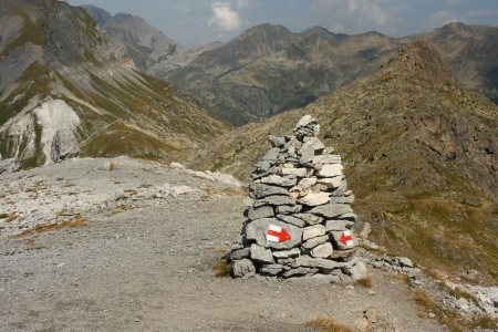 cairn with painted red arrows in Rhone-Alpes  photo