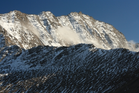 early snow on mountain crest in Alps photo