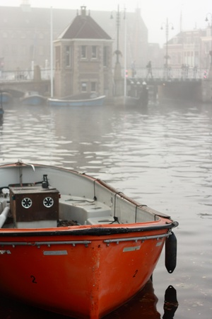 orange vessel on canal in Leiden, Netherlands Stock Photo - 17124478