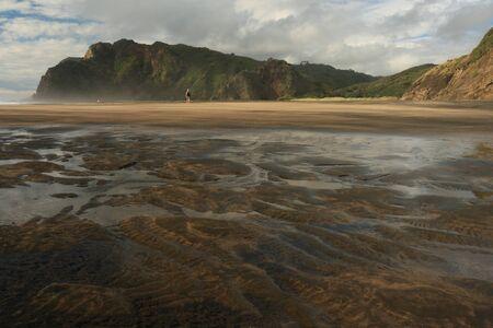 Karekare beach at low tide
