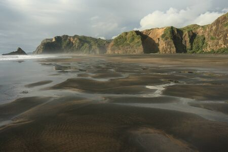 low tide at Karekare beach