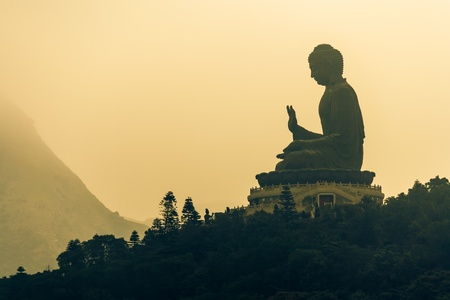 sunrise over Tian Tan Buddha on Lantau Island photo