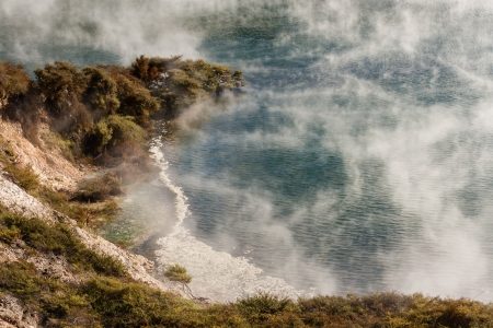 steam raising from thermal lake in Waimangu, New Zealand photo