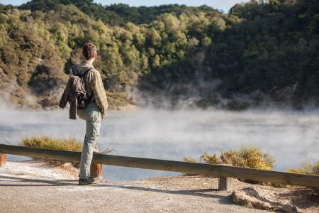 man admiring Echo Crater with Frying Pan Lake in Waimangu photo