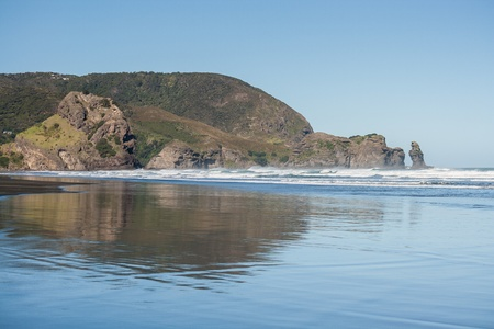 low tide: Piha beach at low tide Stock Photo