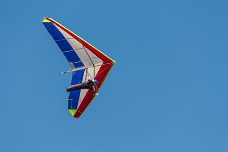 rogallo wing on blue sky 스톡 콘텐츠