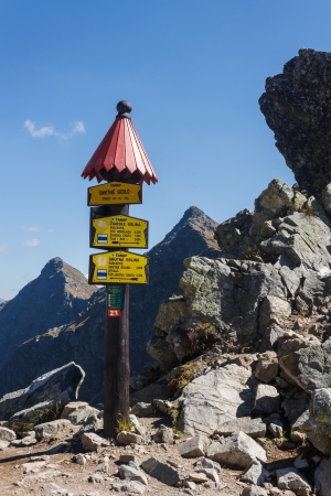 wooden post marking way in Western Tatras photo