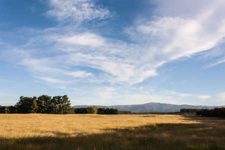 rural countryside: cirrus clouds above rural countryside