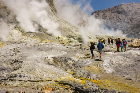 vents: tourists admiring steaming vents on White Island Stock Photo