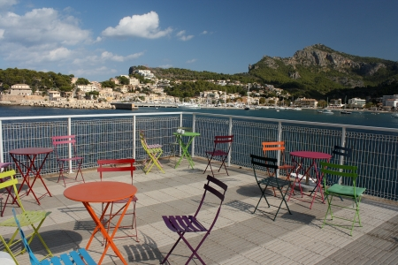 colourful chairs in on beach in Port de Soller photo