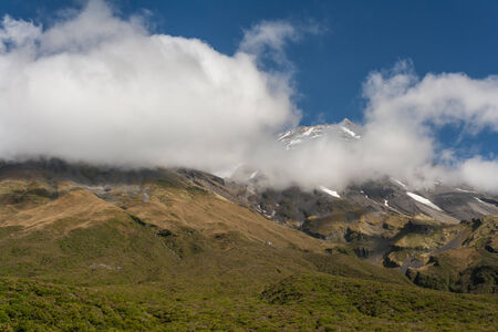 obscured: mount Taranaki obscured by clouds