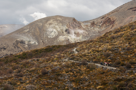 tourists on track to fumaroles in Tongariro National Park photo
