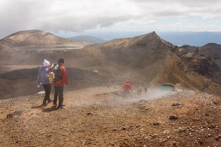 tongariro: tourists on Tongariro Alpine Crossing in New Zealand Stock Photo