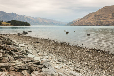 ove: morning mist ove lake Wakatipu in New Zealand Stock Photo