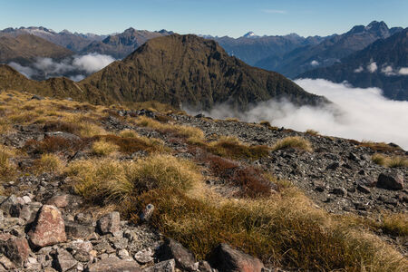 inversion: mountain peaks above inversion in Fiordland National Park Stock Photo