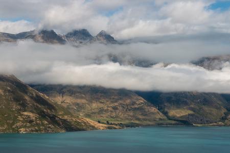 inversion: clouds inversion above lake Wakatipu in New Zealand