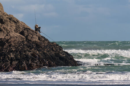 fishermen fishing on volcanic rocks