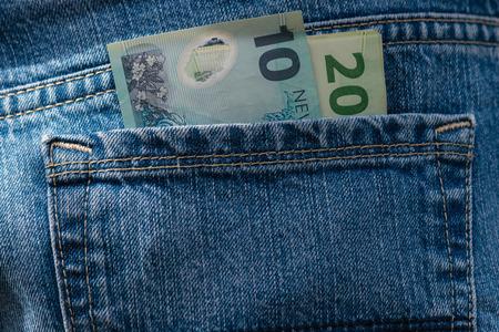 New Zealand dollars in pocket 스톡 콘텐츠