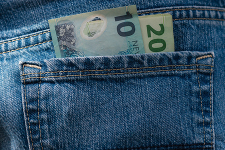 New Zealand dollars in pocket Stock Photo