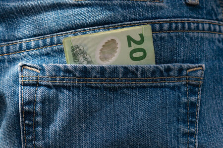 detail of New Zealand dollars in jeans pocket photo