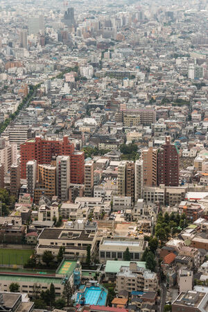 urban sprawl: aerial view of houses in central Tokyo