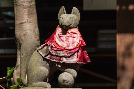 statue of decorated kitsune fox photo