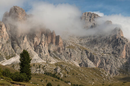 inversion: cloud inversion over mountain range in Dolomites