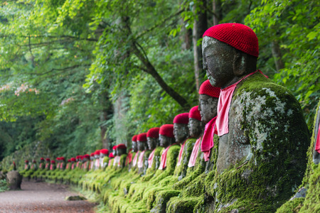 sitting Buddhas in Kanmangafuchi abyss, Japan photo