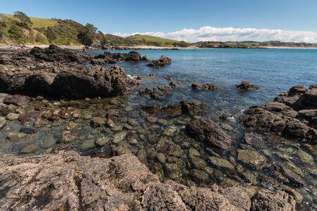 omaha: volcanic rocks on coast at Omaha Bay