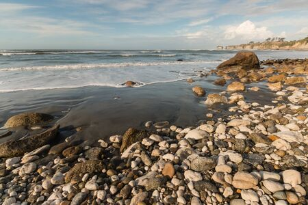 unspoilt: Buller Bay beach on West Coast of New Zealand at low tide Stock Photo