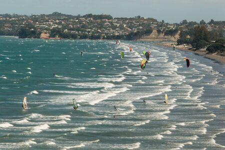 omaha: kitesurfers in Omaha Bay in New Zealand Stock Photo