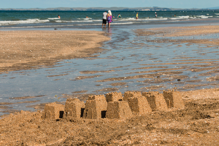 sandcastles: sandy beach with sandcastles