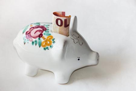 majolica: majolica piggy bank with 10 Euro banknote Stock Photo