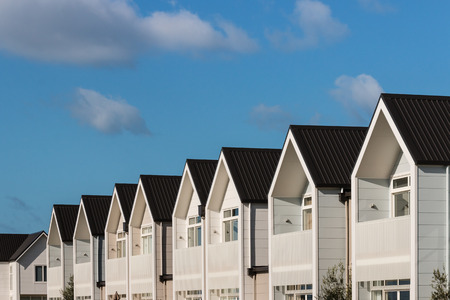 row of white houses against blue sky Stock Photo
