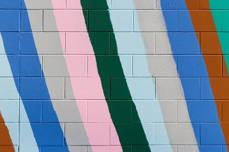 colorful stripes: brick wall with colorful stripes Stock Photo