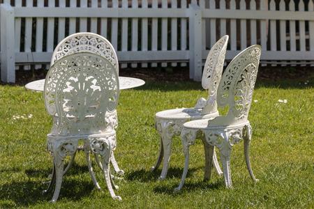 wrought: white wrought iron garden furniture Stock Photo