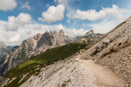 footpath across slope in Dolomites Stock Photo