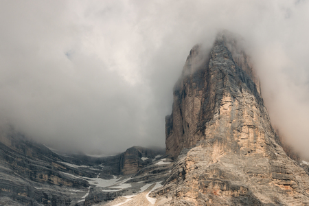 obscured: granite peaks obscured by clouds
