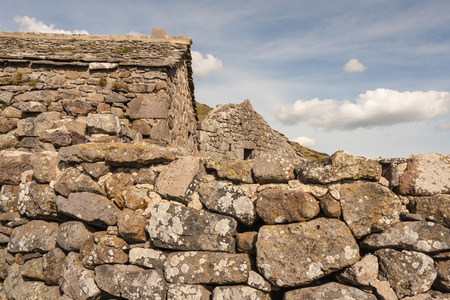 dry stone: closeup of dry stone wall and houses