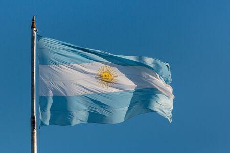 argentina flag: Argentina flag flying on flagpole