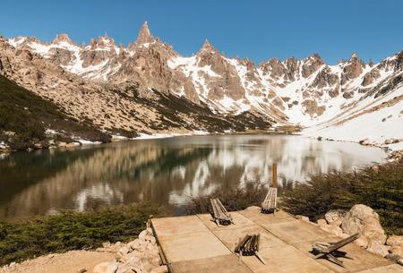 lake nahuel huapi: folding chairs at glacial lake in Andes, Argentina
