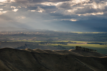 rolling hills: sunset over rolling hills in New Zealand Stock Photo